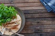 Almond crusted fish with hummus & green chilli oil