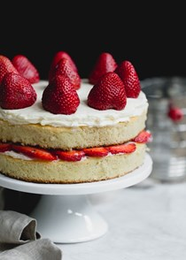 Almond flour strawberry shortcake cake with vanilla bean cream cheese frosting
