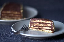 Almond macaroon torte with chocolate frosting