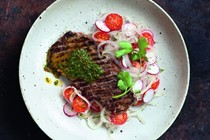 Argentinian-style steak with onion and radish salad