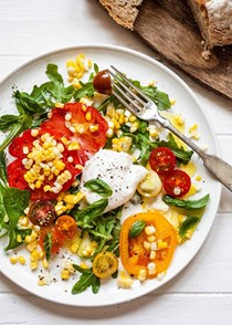 Arugula salad with tomatoes, corn, and burrata
