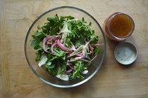 Arugula with pickled red onions, toasted almonds and shaved Parmesan