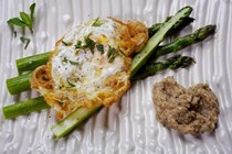 Asparagus with romesco blanco and fried eggs