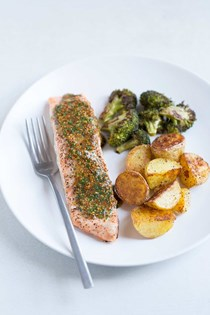 Baked salmon with broccoli, potatoes and mustard-chive sauce