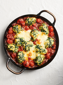 Baked spinach and ricotta gnocchi with cherry tomatoes