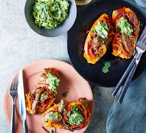Baked sweet potatoes with steak fajita filling