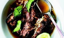 Beef short ribs braised in pho broth with condiments