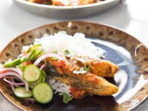 Bengali-style fried fish in onion and tomato curry (Fish bhuna)