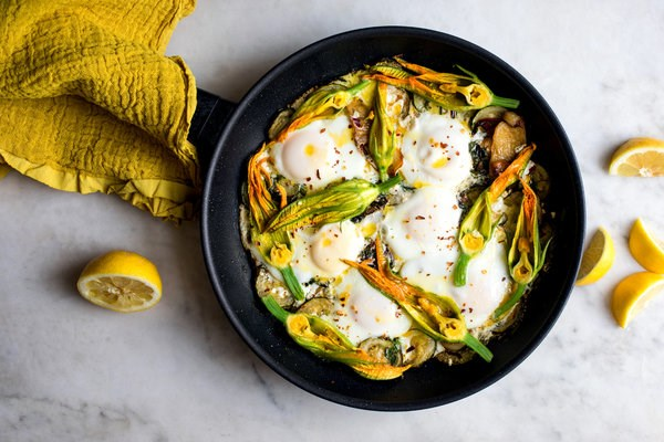 Braised eggs with zucchini, feta and lemon