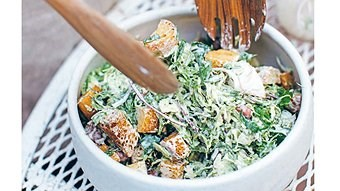Brussels sprout Caesar with croutons, borlotti beans and sunflower seeds