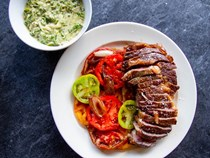Butter-basted steak with creamed shishitos and tomatoes