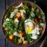 Caesar-style baby greens with poached egg, Parmesan and croutons