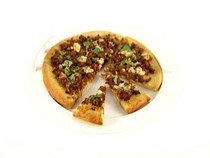 Caramelized onion, sausage, and basil pizza