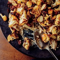 Cauliflower korma with blackened raisins