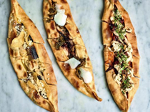 Chicken & garlic köfte pide with chili yogurt, smoked salsa, walnuts & feta