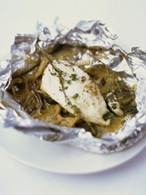 Chicken breast baked in a bag with mushrooms, butter, white wine and thyme