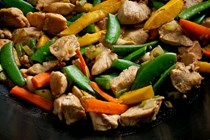 Chicken stir-fry with mango and peanut sauce