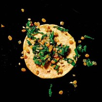 Chickpea crepes with Swiss chard, golden raisins, and pine nuts