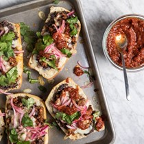 Chorizo molletes with roasted salsa and pickled onion