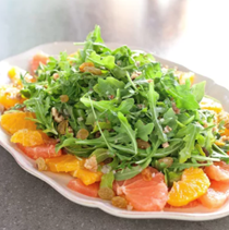 Citrus salad with arugula, golden raisins, and walnuts