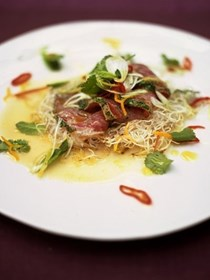 Citrus seared tuna with crispy noodles, herbs and chilli