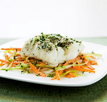 Cod baked in foil with leeks and carrots