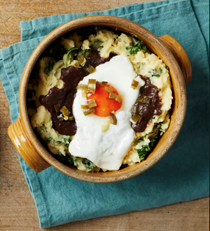 Colcannon with black pudding sauce and fried egg