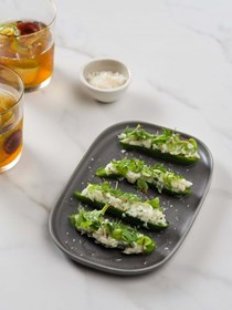Compressed cucumber with salted fish brandade, wild herbs