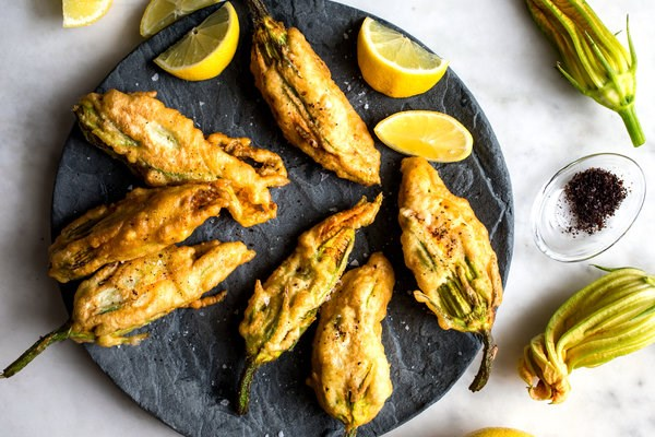Crisp zucchini blossoms stuffed with goat cheese