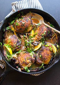Crispy curried chicken thighs with wilted greens