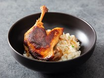 Crispy koji duck confit with garlicky duck-fat rice and umeboshi