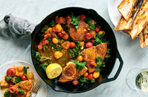 Curried swordfish with tomatoes, greens and garlic toast