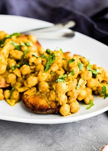 Curry chickpea-loaded baked potatoes