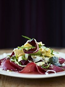 Delicate egg ribbons with bresaola, crispy fennel and spring leaves