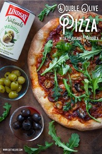 Double olive pizza with sausage and arugula