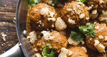 Egg-stuffed Mexican meatballs with salsa roja