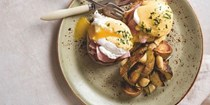 Eggs Benedict with roasted garlic-rosemary potatoes [Cana Flug & Dustin Clark, Besaw's]