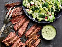 Flank steak with vegetables and green goddess sauce