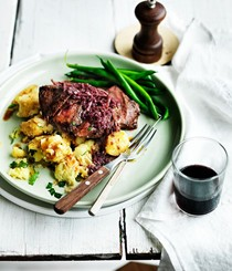 Flat-iron steak with red wine and ginger sauce and crushed potatoes