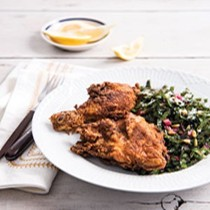 Fried chicken and Swiss chard salad with pine nuts and lemon