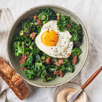 Fried eggs, sausage & kale skillet with tomato aioli