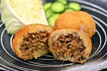 Fried glutinous rice balls filled with larb - Eastern Thai spicy meat salad (Larb Neau)