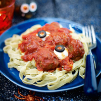 Ghoulish meatballs with wriggly snake pasta