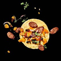 Gluten-free chickpea crepes with sautéed lamb sausage and orange-olive relish