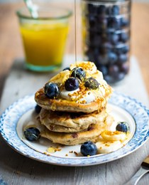 Gluten-free pancakes with blueberry, banana, and honey