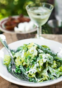 Green salad with peas, green beans, and buttermilk ranch dressing