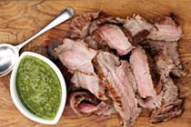 Grilled flank steak with quick green sauce