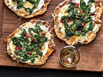 Grilled flatbreads with broccoli rabe, ricotta, and rosemary honey