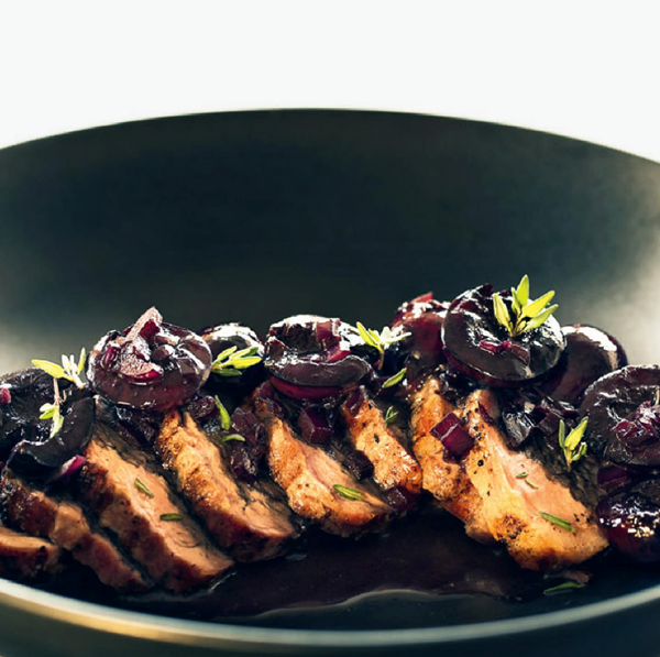 Grilled pork medallions with cherry-bourbon sauce