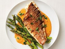 Grilled red snapper and asparagus with red pepper sauce
